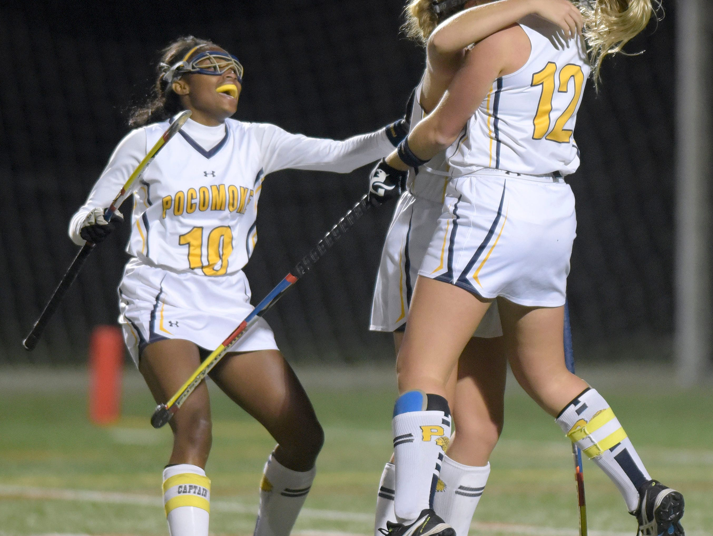 From left, Pocomoke's Shayla Jones, Kasey Lee and Lexi Butler celebrate Lee's goal against Manchester Valley in the second half of a Class 1A state semifinal field hockey game, Wednesday, Nov. 11, 2015 in Burtonsville. (Photo by Steve Ruark)