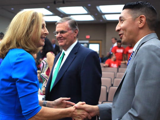 Debbie Lindsey-Opel (from left) is congratulated by Mayor Joe McComb and Councilman Ben Molina after council voted to appoint her to the council's at-large seat on Tuesday, June 20, 2017.