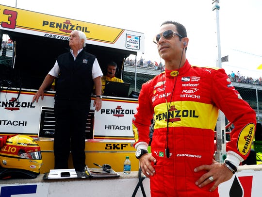 Helio Castroneves watches alongside owner Roger Penske