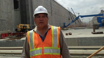 Luis Ferreira, a spokesman with the Panama Canal Authority, surveys the canal's $5.25 billion expansion project.