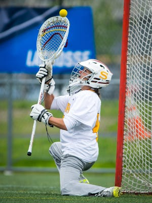 Salisbury University goalkeeper Giana Falcone (46) tips a ball against Franklin and Marshall in the NCAA Division 3 Women's Lacrosse Regional Final on Sunday, May 22 at Sea Gull Stadium in Salisbury.