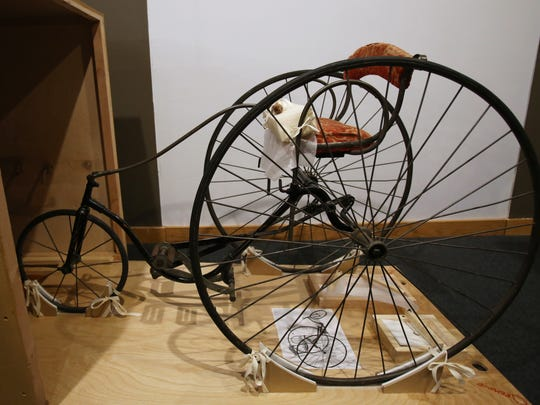 This Feb. 17, 2015 photo shows a children's tricycle, circa 1885,  on display in a new exhibit on bicycling in Wisconsin at the Wisconsin Historical Museum in Madison, Wis. The exhibit is a partnership with the History Museum at the Castle in Appleton, where the exhibit will go after its run in Madison.(AP Photo/Wisconsin State Journal, Amber Arnold)