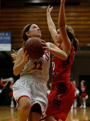 Lincoln's Carley Zimmer (22) goes up for two against Green Bay East at Manitowoc Lincoln High School Tuesday, Nov. 28, 2017, in Manitowoc, Wis. Josh Clark/USA TODAY NETWORK-Wisconsin