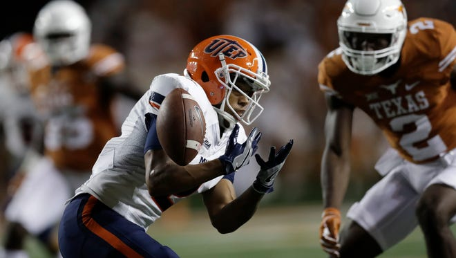UTEP's Terry Juniel, left, bobbles and fumbles a punt during the second half of a NCAA college football game against Texas, Saturday, Sept. 10, 2016, in Austin. UTEP recovered the fumble.