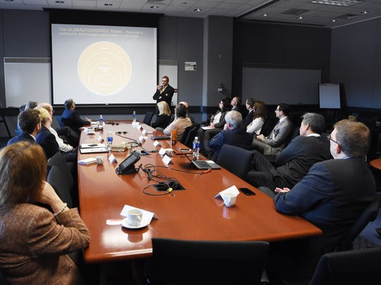 Mike Russo, director of government relations and regulatory affairs at GlobalFoundries, speaks to a group of community leaders at the East Fishkill site.