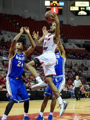 UL guard Kasey Shepherd (5) drives to the basket against McNeese State earlier this season.