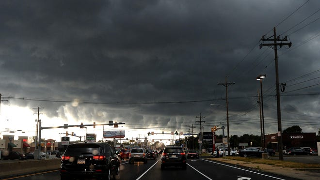 Storm clouds pass over West 12th Street and Pittsburgh Avenue in Erie on Thursday. Storms brought heavy rains and high winds to the area.