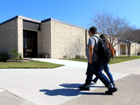 Students pass by the Heldenfels Administration Building