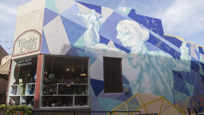 Since the Fort Collins Mural Project did most of its murals as a pilot project on a building that was set to be torn down, ÒOn the Shoulders of GiantsÓ by Stanley Scott in Trimble Court is the only one still in existence Monday, August 22, 2016.
