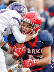 Chenango Forks' Jeremiah Allen is tackled by Norwich's Thomas Parrella during the Section 4 Class B Championship at Binghamton Alumni Stadium. Allen rushed for 272 yards in Forks' 49-21 victory.