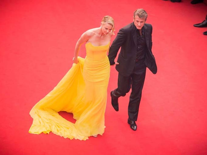 Actors Charlize Theron and Sean Penn attend the Premiere