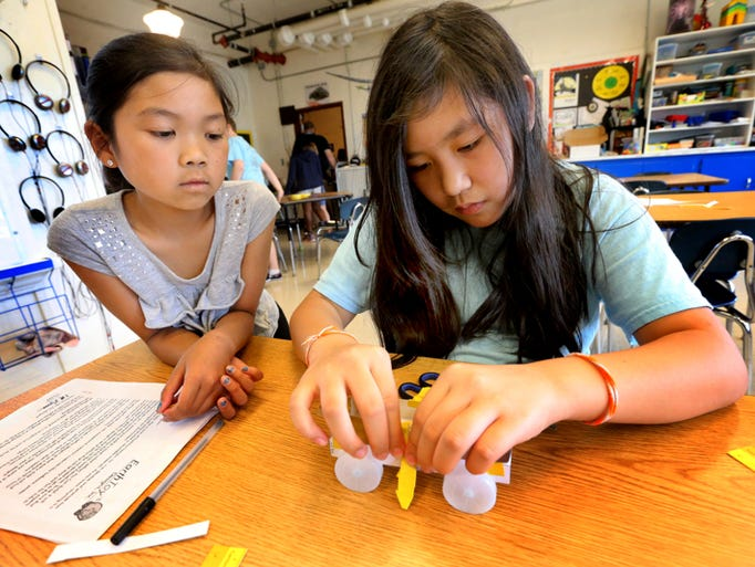 Fourth grader at Campus School Kennedy Vixayvong, left