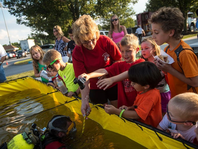 Diane Alwine of the Penn Township Dive Team, helps