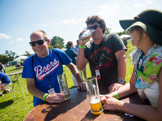 """Adam Zei, left, of Gettysburg, enjoys beers with friends"