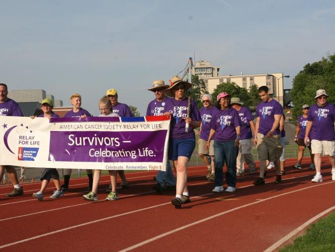 Community fund raises to help find a cure for cancer during this year's Relay for Life at Ithaca College on Saturday, July 12.