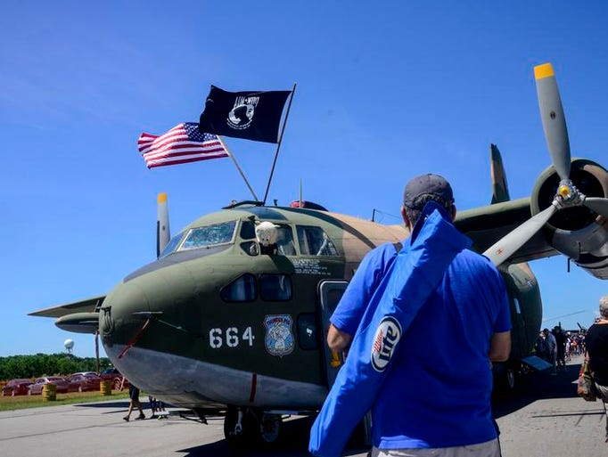 Juan Medina, of Vestal, takes a photo of the C-123 Thunder Pig during the second day of the 2014 Greater Binghamton Airshow on Saturday.
