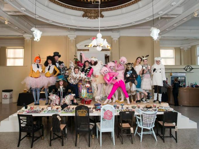 The Carnegie hosted an opening reception for its Art of Food exhibition, which runs through March 15. The photo of members of The Mad Hatter's Tea Party pose for a group photo.