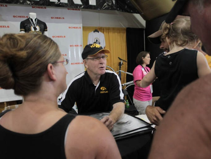 Dan Gable chats with fans at FryFest in Coralville on Friday, Aug. 30, 2013.