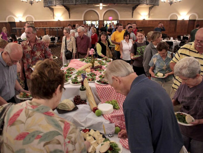 Guests browse various cheeses during the annual Lunch with the Chefs event at the Iowa Memorial Union on Wednesday, June 26, 2013.