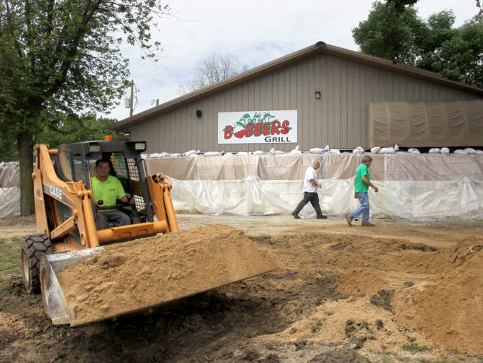 Volunteers construct a floodwall around Bobbers Grill in North Liberty on Saturday, June 1, 2013.