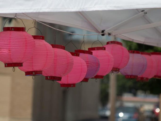 Paper lanterns sway at the 2014 Summerfest at McCamly Park.