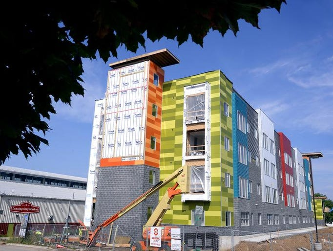 The colorful Market Place Urban Flats development under construction near the Lansing City Market  Tuesday, August 19.