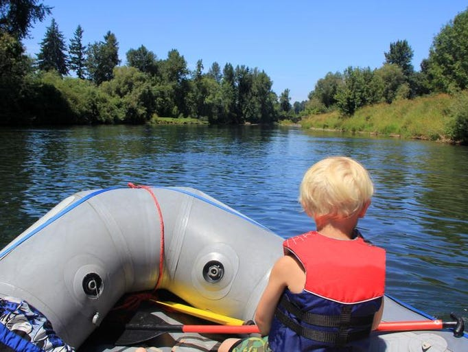 Noah Peters looks out on the Willamette River during a trip from Spring Valley Access to Grand Island Access.