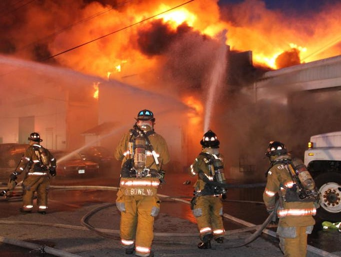 Firefighters at the scene Thursday night of a commercial building fire along Lake Street in Salisbury.