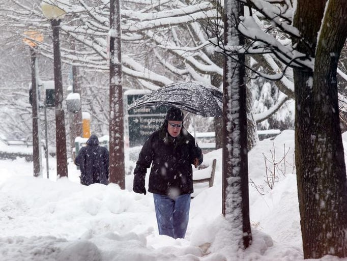 "Jim Lader of Bronxville braves the snow to talk in town in Bronxville Feb. 13, 2014. ""I grew up in the midwest so this snow doesn't bother me. You just have to be in the right frame of mind... soon it will be too hot to do anything,"" says Lader of all of this snow this year."