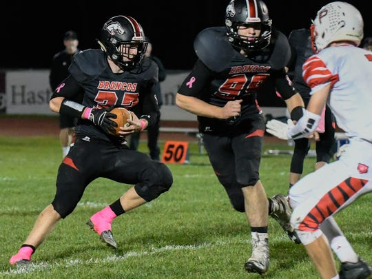 Bellevue RB Ryan Madry (32) looks for a gap during game action Friday night.
