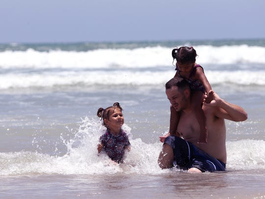 Higher-than-normal tides didn't deter beach-goers at