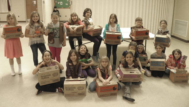 The girls of Brownie Troop #21002 of York are shown with their boxes of cookies.