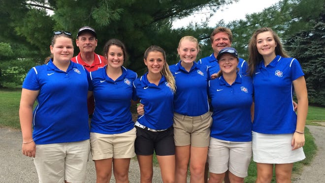 (Front, from left to right) Megan Schudlich, Ashley Griffor, Maia Cataldo, Claire Brooks, Kara Likins and Savanna Green pose with coaches Mark Day (back left) and Ken Mareski (back right).
