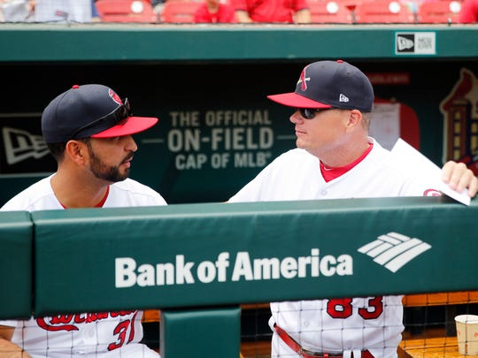 St. Louis Cardinals interim manager Mike Shildt, right, talks with first base coach Oliver Marmol before the start of a baseball game against the Cincinnati Reds Sunday, July 15, 2018, in St. Louis. (AP Photo/Jeff Roberson)