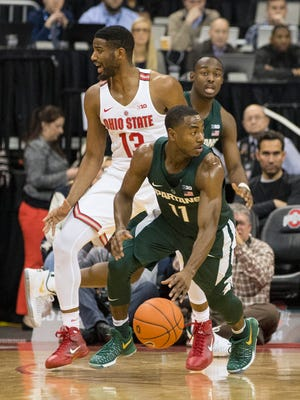 Michigan State Spartans guard Lourawls Nairn Jr. (11) controls the ball as Ohio State Buckeyes guard JaQuan Lyle (13) defends at Value City Arena in Columbus, Ohio Jan 15, 2017.