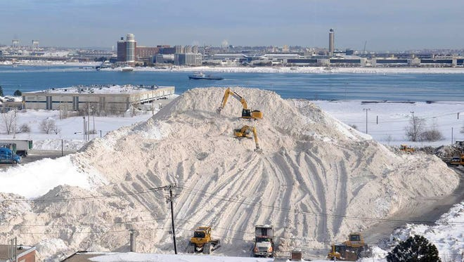 In this Feb. 18, 2015, photo, snow piles up in Boston. Mayor Martin Walsh announced  July 14 that the last pile of snow from the record-setting winter was officially gone.