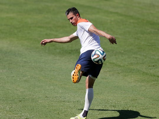 Robin van Persie of the Netherlands, kicks the ball during their official training session in Fortaleza, Brazil, Saturday, June 28, 2014.  Netherlands will play Group A runner-up Mexico in the second round on Sunday in Fortaleza.(AP Photo/Wong Maye-E)