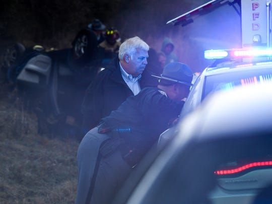 Anderson County Coroner Greg Shore, middle, reviews information with a state trooper after a 64-year old man died in a single car accident on High Shoals Road, near Abbeville Highway, at 6:40 a.m. in Anderson County this month. Shore said a witness saw the dark blue Kia Spectrum slide sideways off the road off in icy conditions, rolling over and ejected from the vehicle. Shore said the black ice and the driver not wearing a seatbelt contributed to the fatality.