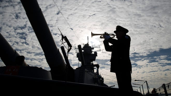 Greg Murphy plays the Navy Hymn during a ceremony commemorating the 75th anniversary of the Dec. 7, 1941 Japanese attack on Pearl Harbor, on board The Battleship New Jersey Museum and Memorial in Camden, N.J., on Dec. 7, 2016.