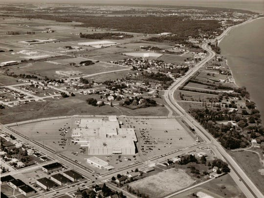 A 1975 aerial photo shows the Mid-Cities Mall in Manitowoc. The Edgewater Plaza opened nearby in 1979.