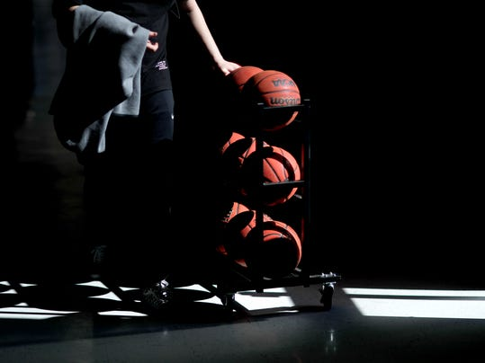 A Georgia State equipment manager pushes a rack of basketballs down a hallway following a men's NCAA college practice in Atlanta, Monday, March 12, 2018. (AP Photo/David Goldman)