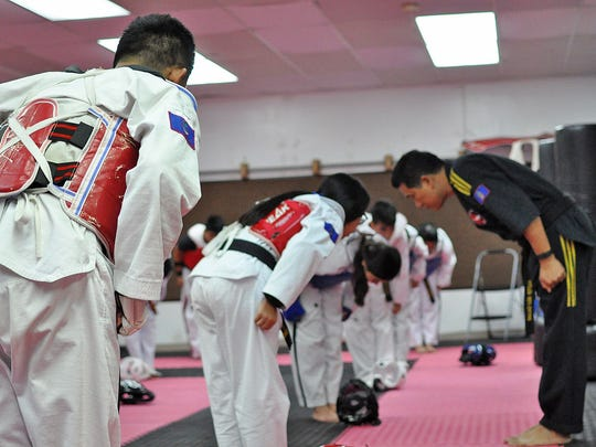 Students of Guam Taekwondo Center bow at the end of class as a sign of respect to their instructor Master Noly Caluag, fifth degree black belt and owner of GTC.