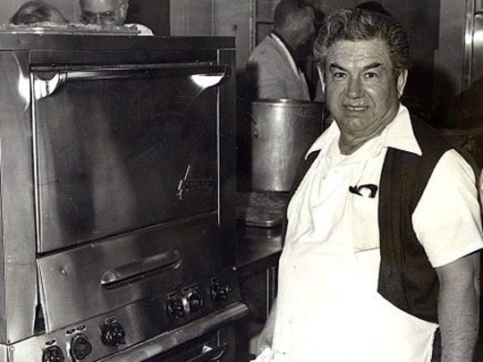 Viva La Comida is a longtime project of the Rotary Club of Camarillo. Here, at the first event in 1971, Camarillo Rotarian Mike Loza cooks enchiladas in the kitchen of theCamarillo Community Center. He would prepare them at his El Tecolote Restaurant, then would take them to the center, where he and volunteers would cook them in the oven. Loza died in 2001 at the age of 84.
