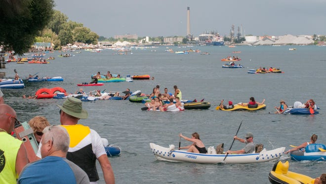 Floaters travel down the St. Clair River during floatdown Sunday, Aug. 21 near the Moose Lodge in Port Huron.