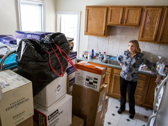 Nora Whisnant looks at a pile of donations as volunteers