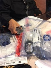 Michigan State Police show badges and other official