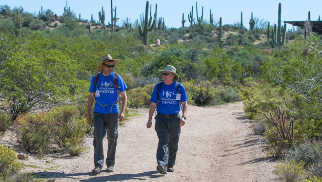Eric Salmon (left) and David Smith walk the path at Brown's Ranch Trailhead in Scottsdale on Oct. 11, 2014.