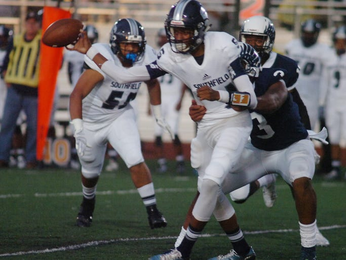 Southfield freshman quarterback Sam Johnson was corralled