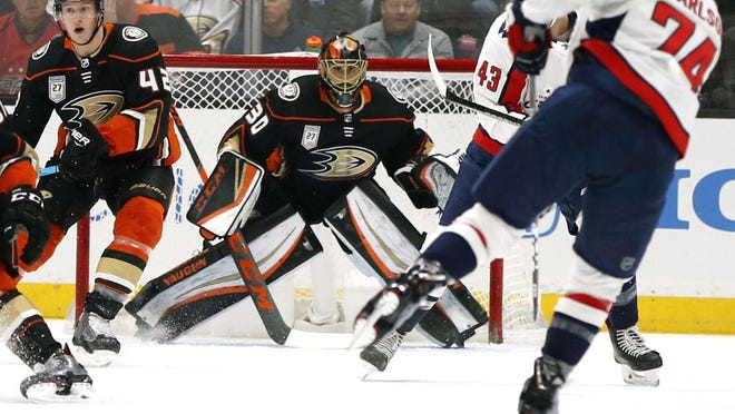 Ryan Miller, an East Lansing native and former Michigan State standout, became the all-time leader in wins by a U.S.-born goaltender Sunday night as he made 23 saves in the Anaheim Ducks 5-2 victory over the Washington Capitals on Sunday night.