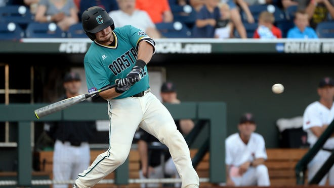 Coastal Carolina Chanticleers catcher David Parrett (12) drives in the first run of the game against the Texas Tech Red Raiders in the second inning  at the 2016 College World Series  at TD Ameritrade Park.